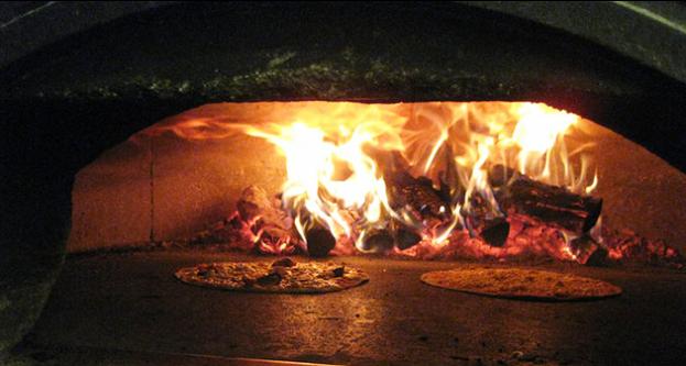 Tiempo fugaz la toscana una delicia de pizzas for Pala horno pizza